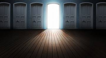 Abstract image of one open door, flanked by many closed doors
