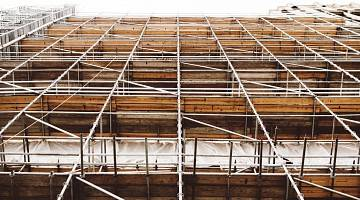 A view from the ground up of construction scaffolding around a building