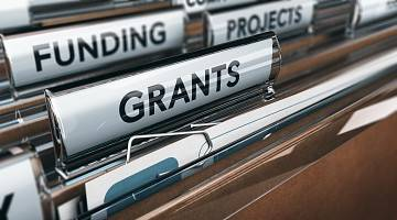 Close-up of file folders of funding projects