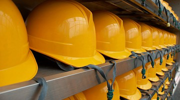 Close-up of hard hats on shelves