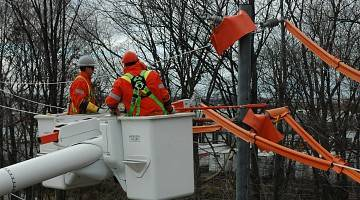 Utility workers fix cable