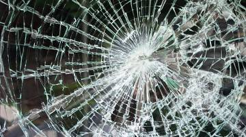Close-up image of shattered glass window