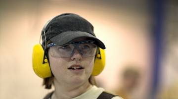 Young worker in hearing protection